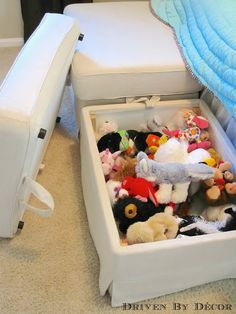 IKEA storage ottomans - awesome for hiding toys or stuffed animals in a kid's room. Also works as seating!