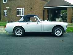 My first car!  MG Midget convertable!  Loved!