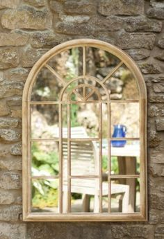 Metal garden mirror finished in a stone effect. This mirror can be used both as an outdoor mirror or indoors.Make smaller gardens or conservatories feel larger with this arched mirror.We have various garden mirrors available, please contact us for more information.