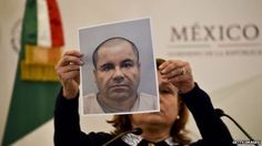 "Mexico's Attorney General Arely Gomez shows a picture of Mexican drug kingpin Joaquin ""El Chapo"" Guzman"