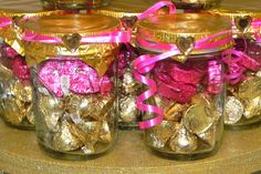 Candy jar gifts.  I made these with mason jars, chocolate raspberry candy and chocolate almond kisses.