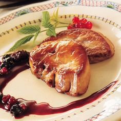Slices of duck Foie Gras pan fried with red   berrie