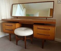 Maybe DIY Vanity by joining  2 end tables with a top and mirror