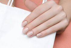 Beautiful female hand with beige nail design. Beige Nails, Trends, Nails Magazine, Wellness Tips, Nails On Fleek, Face Shapes, Swarovski Crystals, Nail Designs, Beautiful Women