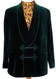 Traditional green velvet smoking jacket with frogging, braiding and shawl collar. Buy online at Tweedmans Vintage.