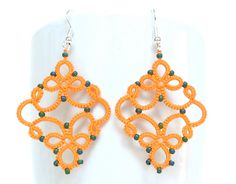 Orange  tatted earrings with teal glass beads. $15.00, via Etsy.