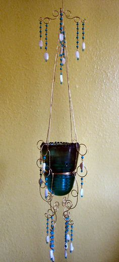 Antique teal hanging glass insulator.