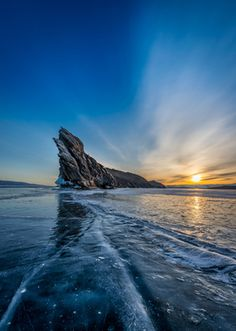 Sun rising over the frozen Lake Baikal. Siberia, Russia.