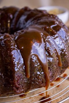 Ginger Sticky Toffee Pudding Cake is a classic English dessert! Chopped dates make it incredibly moist, but then we dump warm buttery caramel sauce on it. Sticky Ginger Cake, Sticky Date Cake, Sticky Toffee Pudding Cake, Caramel Pudding, English Dessert Recipes, English Cake Recipe, Toffee Cake Recipe, Moist Date Cake Recipe, Homemade Toffee