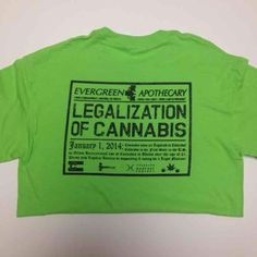 LEGALIZATION CANNABIS WEED T-SHIRT SMALL Size small Evergreen Apothecary women's /unisex T-Shirt. Evergreen was one of the first dispensaries in Denver Colorado to sell legal marijuana on 1/1/14. This shirt is new, never worn.  I have several of these, if you'd like more than 1 just ask :) only size small available. Tops Tees - Short Sleeve