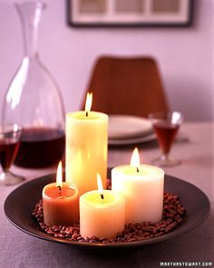 Arrange pillar candles of different sizes and colors in a serving platter or shallow bowl. Then, surround the candles with a layer of dried beans (we used kidney beans, but pink lentils, red beans, and red rice also work nicely). Beans make cleanup of the wax easy, and unify a group of candles into a true centerpiece.