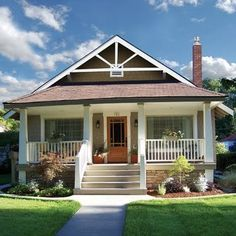 This porch is similar to how I want ours to look when finished. The roof of the porch would have another peak like the roof of the house, rather than being sloped like the one pictured here.
