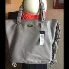 New BCBG Paris Fringe Tote New with tags's has magnetic top closure, interior zip  closure pocket and two drop pockets, adjustable buckled straps, strap drop is 8 inches,  100% polyurethane, color is taupe. BCBG Bags Totes