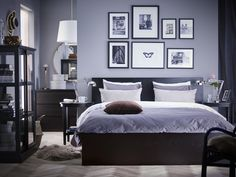 A black-brown MALM bed frame with a grey comforter and white striped pillows. A side table on each side of the bed with gallery images of plants and butterflies hanging above the bed. Ikea Bedroom Sets, Bedroom Bed, Bedroom Furniture, Bedroom Decor, Bedrooms, Dream Bedroom, Ikea Lit Malm, Cama Malm Ikea, Hack Ikea