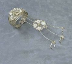 MORE THAN A BRACELET...HAS 3 RINGS AND A FOUR LEAF CLOVER.  Hand made silver filigree cuff with three anchoring rings and a dangling four leaf clover. 1.67 oz. Dangling elements can be easily removed to become something else. Priced at $275.00, save $55 if you order by 6/20/14.    FREE POSTAGE WITHIN THE US. BUYER PAYS POSTAGE FOR INTL & EXPEDITED WORLDWIDE. Contact:  LoliBJewelry@lbcmc.com