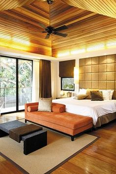 Since the master bedroom is where the Ligoneses spend time the most, comfort is key. But comfort doesn%u2019t equate to banality%u2014the vaulted ceiling, paneled headboard, and Moroccan hues of brown and orange provide drama and style.