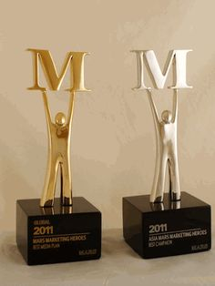 "Mars, one of the worlds leading food manufacturers, recently commissioned a new custom award design from Bennett Awards for their ""Marketing Heroes"" program. The Marketing Heroes awards are given each year to company associates in order to recognize their outstanding achievements in marketing.  These custom trophies feature an impressionistic figure holding up the ""M"" from Mars' logotype. These trophies are cast in pewter, and feature either bronze (global) or silver (regional) plating."