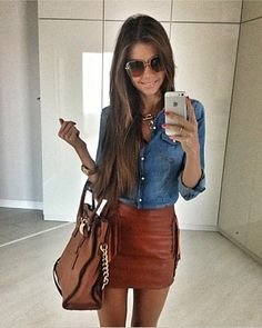 Jean top with brown leather skirt to die for!