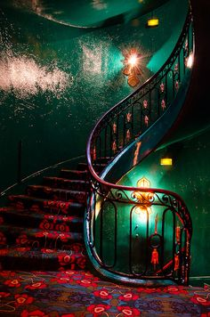 "Maxim's stairs, Paris. Same color scheme as in the movie ""Amelie."" I love it when red and green don't looks Christmas-y but actually chic and dramatic. Tricky, but inspiring to see when it works."