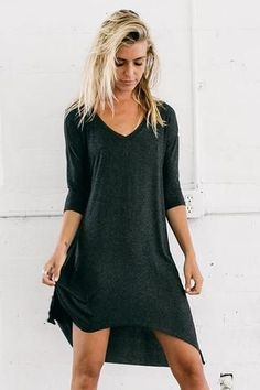 Simple yet stunning, this tunic-style dress features a flowy high/low asymmetrical skirt, dolman sleeves, and a flattering V-neck. Color: Charcoal Size: S/M (0-4), M/L (6-10) Fabric: 95% Ribbed Rayon/