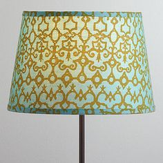 I added this shade to a vintage base - it adds a surprising burst of pattern and color to the room - it makes me happy!