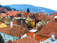 #Orange colors #giclée fine art Interior #decor photo print. For home, office and businesses. Photograph of Transylvania Rooftops by Judi Saunders.