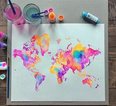 world map in diluted acrylics