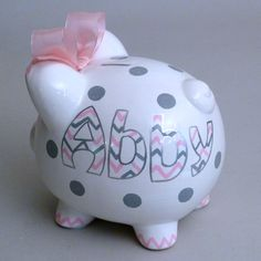 Large girly Personalized Chevron Piggy Bank from Neat Stuff Gifts features baby's name hand painted in stylish pink and gray.