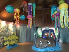 "This was our Narthex, the foyer entrance to the church. Deep Sea Discovery, VBS2016.the ""cracken"" is our baptismal font, a large ROCK from the Sea of Galilee. The whale mouth entrance to the church itself (Nave) and the bubble wall behind the photo sub were favorites for parents to take pictures."