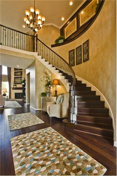Love the curved staircase and sitting area at the base of it. Really elegant…