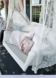Wicker porch swing with vintage lace at Creative Country Mom's Garden