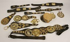 "The collection includes antique horse tack brasses and nine leather straps mounted with brass medallions (motifs include hearts, crown, castle and geometrics), two are marked ""H. C. Boyers, Saddler, Marketrasen,"" along with three loose brasses. The brasses were offered with a copper and brass mounted hoof inkwell, inscribed ""Tommy, Died December 1st, 1875."""