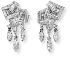 A pair of diamond earclips, 1950