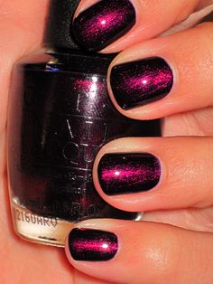 This is what I'm (WSR) wearing right now and I LOVE it. It looks black and then this fiery reddish purples hen the light hits it!!!-- OPI Every Month Is Oktoberfest