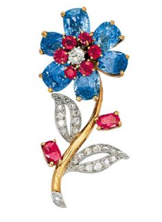 A Retro Sapphire, Ruby and Diamond Brooch, Cartier, circa 1940  Designed as a single flower blossom with an old mine-cut diamond and ruby pistil, sapphire petals, diamond leaves and ruby buds, mounted in 9K Gold, signed Cartier, London, numbered 557