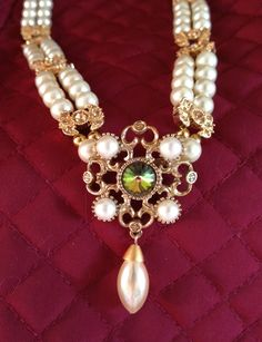 Renaissance or Victorian double-strand glass pearl necklace by Karen Troeh incorporating a vintage brooch and jeweled links. This one is sold, but visit my Etsy shop to contact me about making a similar one for you!