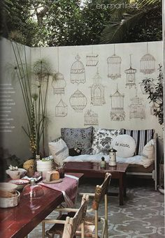 Ooh - talk about bringing the outside in- painted antique birdcages on the concrete wall and also painted a stencil pattern on the concrete patio ground to create a rug-effect! Outdoor Rooms, Outdoor Living, Outdoor Furniture Sets, Outdoor Decor, Outdoor Art, Outdoor Fabric, Indoor Outdoor, Green Design, Patio Wall