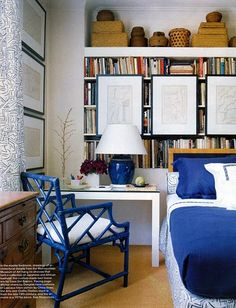 Like the library behind this bed & desk used as side table. Triple function for a guest room.