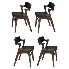 Four Danish Rosewood and Black Leather Dining Chairs 1