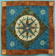 """Wall Quilt """"In Circles"""" by Sharon Pollock """"Mariner's Compass is my favorite traditional quilt pattern I return to again and again. I had fun using up bits and beads. Traditional Quilt Patterns, Mariners Compass, Capital City, Circles, Have Fun, Quilting, Beads, My Favorite Things, Rugs"""
