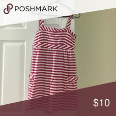 Sleeveless American Eagle dress No sleeve pink and white striped American Eagle dress with two pockets and it ties in the back American Eagle Outfitters Dresses
