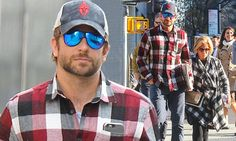 Bradley Cooper cuts a coordinated figure with his mother in plaid