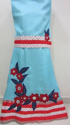 Description - An outworn pale rida revamped stylishly into a baby blue jute rida using appliques with contrast trims.