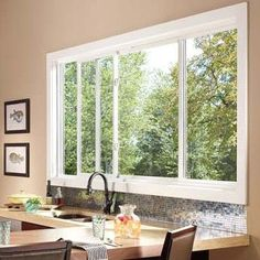 Learn more about the fiberglass and vinyl Pella sliding windows and check out the different series available. Pella Windows, Porch Windows, Sliding Windows, House Windows, Kitchen Windows, Sliding Door, Home Upgrades, Slider Window, Fiberglass Windows