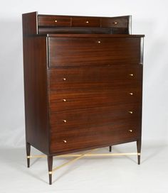 Tall and Handsome Gentleman's Chest by Paul McCobb for Calvin | From a unique collection of antique and modern dressers at https://www.1stdibs.com/furniture/storage-case-pieces/dressers/