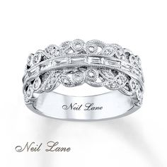 This breathtaking vintage-inspired ring from Neil Lane Designs® showcases a line of bold baguette diamonds complemented by romantic milgrain detailing and round diamonds. The white gold ring has a total diamond weight of carat. Engagement Ring Buying Guide, Perfect Engagement Ring, Traditional Engagement Rings, Anniversary Bands, Neil Lane, Diamond Stone, Antique Rings, White Gold Rings, Fashion Rings