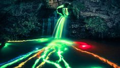 Long-exposure photography transforms the scenic waterfalls of Northern California into psychedelic spectacles using high-powered glow sticks.