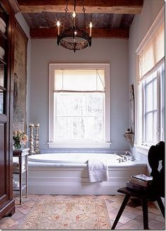 Another beautiful bathroom that could be a sitting room. Feminine and rustic at the same time.
