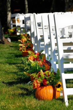 pumpkin and flowers fall wedding aisle