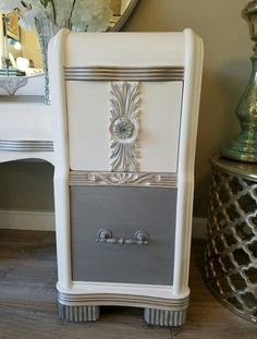 Repurposed, upcycled and refinished this amazing Vintage waterfall vanity, mirror and chair. I'm pinning another pic too :) This was done in Rustoleums Linen White chalk paint, silver paint and gilding wax. Sanded topped with a clear wax then added the silver with glass knobs and silver sprayed pulls. I did the bottom 2 in a metallic silver. Absolutely Love this one! You can see more on my FB Page https://www.facebook.com/ChicandShabbyFurnitureByRebecca
